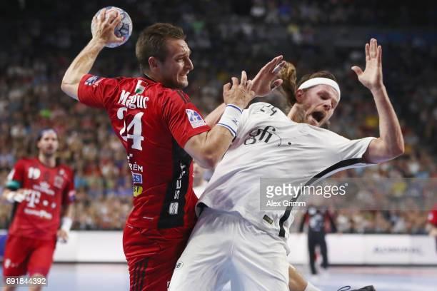 Gaspar Marguc vv is challenged by Mikkel Hansen of Paris during the VELUX EHF FINAL4 Semi Final between Telekom Veszprem and Paris SaintGermain...