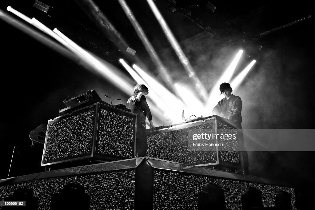Gaspard Auge and Xavier de Rosnay of the French band Justice perform live on stage during a concert at the Columbiahalle on October 20, 2017 in Berlin, Germany.