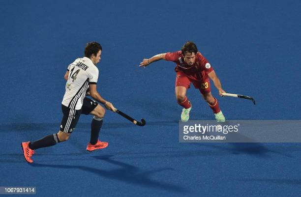 Gaspard Baumgarten of France looks on as Josep Romeu of Spain is in action during the FIH Men's Hockey World Cup Pool A match between Spain and...