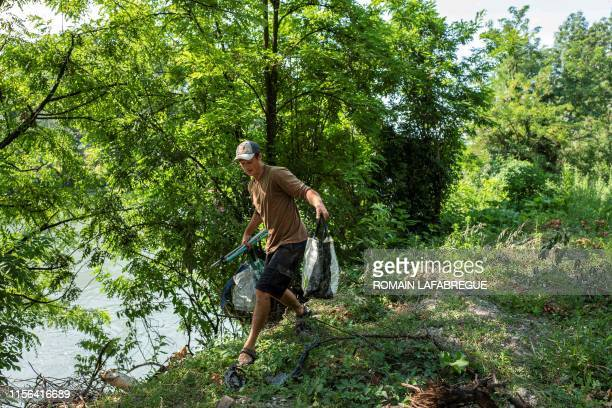 Gaspard Forest carries waste he collected from the Isere river on July 17 2019 in La tronche Gaspard Forest collects waste from the river for six...