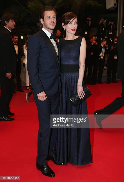 Gaspard Ulliel and Gaelle Pietri leave the Saint Laurent premiere during the 67th Annual Cannes Film Festival on May 17 2014 in Cannes France