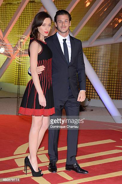 Gaspard Ulliel and guest Gaelle attend the the 'Cinecoles Jury Members' photocall during the 14th Marrakech International Film Festival on December...