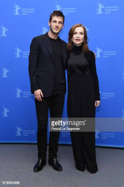 Gaspard Ulliel and Isabelle Huppert pose at the 'Eva' photo call during the 68th Berlinale International Film Festival Berlin at Grand Hyatt Hotel on...