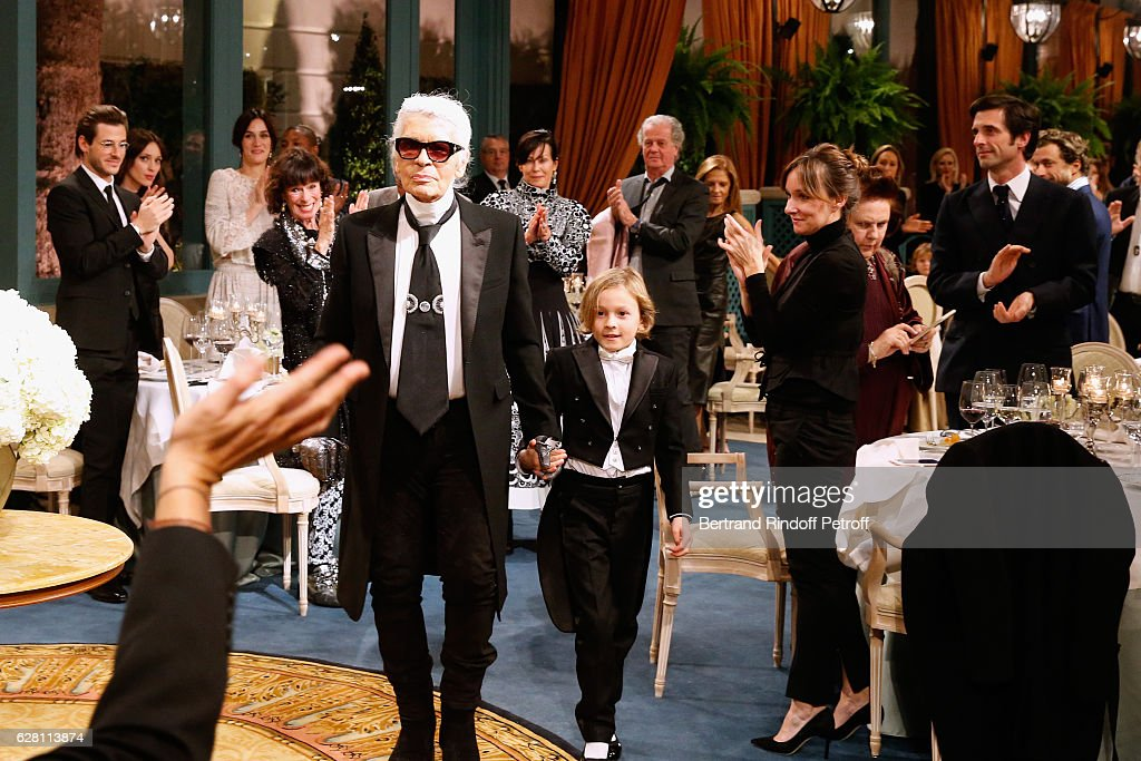 Gaspard Ulliel, Gaelle Pietri and Geraldine Chaplin applause Stylist Karl Lagerfeld and his Godson Hudson Kroenig, who acknowledge the applause of the audience at the end the 'Chanel Collection des Metiers d'Art 2016/17 : Paris Cosmopolite'