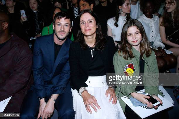 Gaspard Ulliel Nathalie Pavlovsky and her daughter attend the Chanel Cruise 2018/2019 Collection Photocall at Le Grand Palais on May 3 2018 in Paris...
