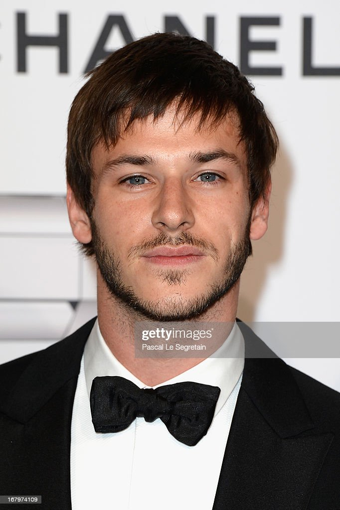 Gaspard Ulliel poses during a photocall for 'N°5 Culture Chanel' exhibition at Palais De Tokyo on May 3, 2013 in Paris, France.