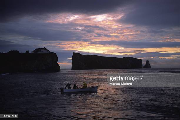 fishing near perce rock at sunrise. - gaspe peninsula stock pictures, royalty-free photos & images