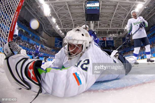 Gasper Kroselj of Slovenia gives up a goal to Jordan Greenway of the United States in the second period during the Men's Ice Hockey Preliminary Round...