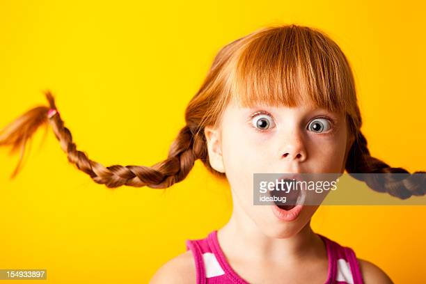 Gasping Red-Haired Girl with Upward Braids and Surprised Look
