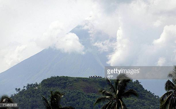 Gasrich lava emitting dark brown smokes rolls down along the gulley from the crater of Mayon volcano while undergoing mild eruption as viewed from...