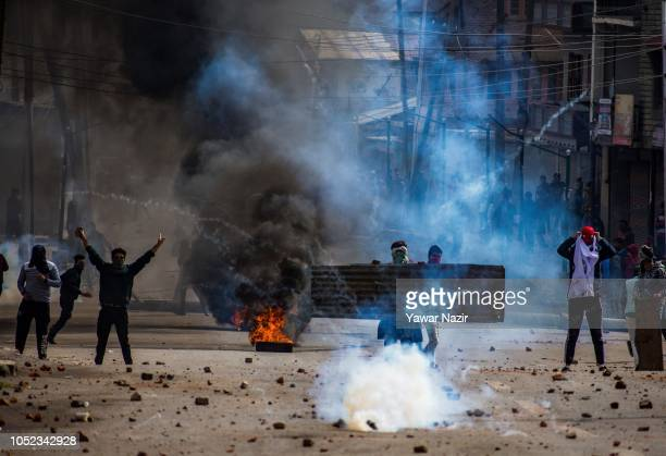 Gassed Kashmiri protesters clash with Indian government forces near the site after a gun battle between Indian government forces and Kashmiri rebels...
