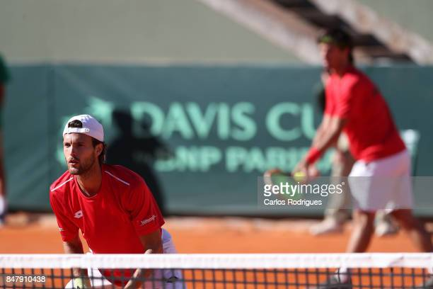 Gastao Elias from Portugal and Joao Sousa from Portugal during the match Portugal v Germany for Davis Cup World Group Playoff Day Two at Centro de...