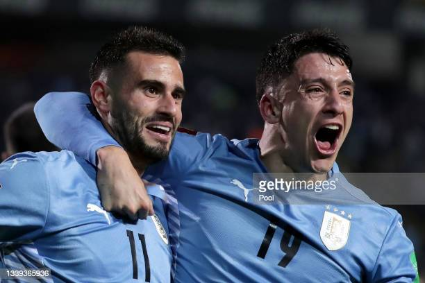 Gastón Pereiro of Uruguay celebrates with teammate Joaquín Piquerez after scoring the first goal of his team during a match between Uruguay and...