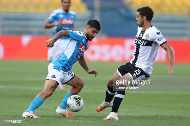 Gaston Brugman of Parma Calcio battles for the ball with Lorenzo Insigne of SSC Napoli during the Serie A match between Parma Calcio and SSC Napoli...