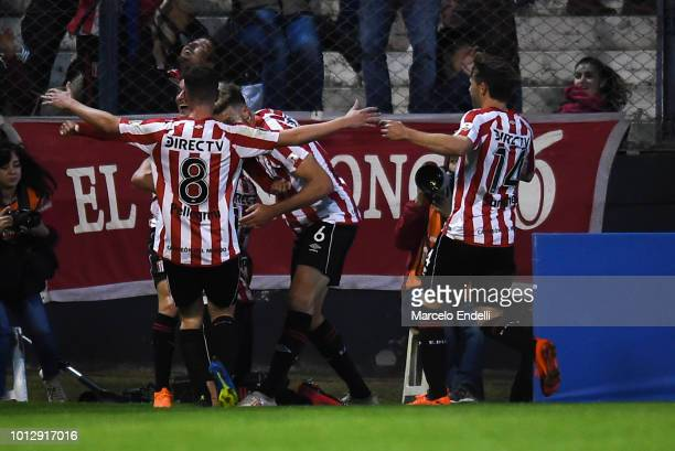 Gaston Campi of Estudiantes celebrates with teammates after scoring the second goal of his team during a round of sixteen first leg match between...