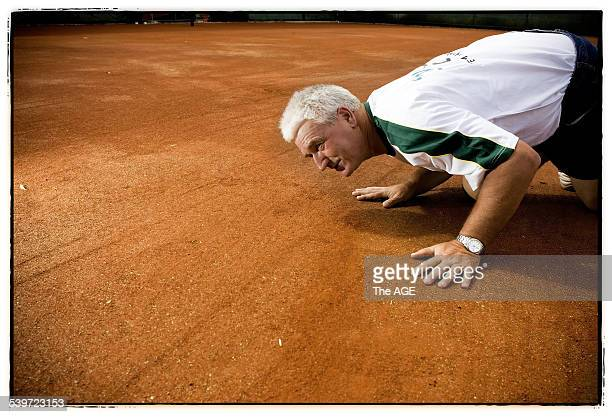 Gaston Cloup photographed inspecting his clay court at Melbourne Park 30 November 2005 THE AGE Picture by JOHN DONEGAN