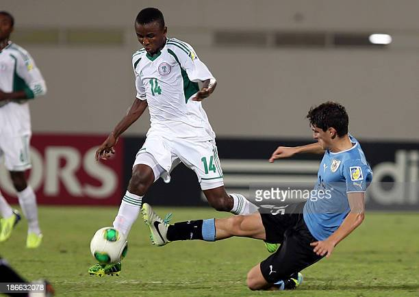Gaston Faber of Uruguay fights for the ball against Chidiebere Nwakali of Nigeria during their FIFA U17 World Cup UAE 2013 football match in Sharjah...