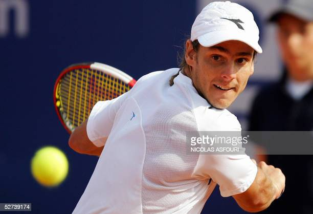 Gaston Gaudio of Argentina returns a back hand against Guillermo GarciaLopez of Spain on the centre court in the semifinal of the Estoril Open in...
