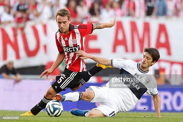 Gaston Gil Romero of Estudiantes fights for the ball with Alvaro Fernandez of Gimnasia y Esgrima La Plata during a match between Estudiantes and...