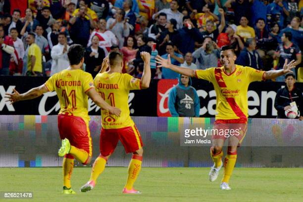 Gaston Lezcano of Morelia celebrates with teammates after scoring the first goal of his team during the 3rd round match between Morelia and Santos as...