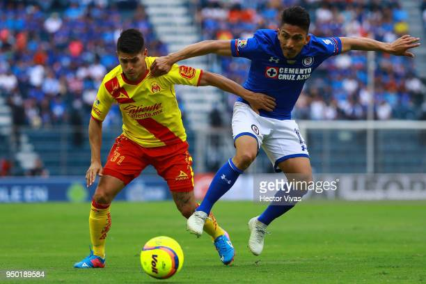 Gaston Lezcano of Morelia struggles for the ball with Angel Mena of Cruz Azul during the 16th round match between Cruz Azul and Morelia as part of...
