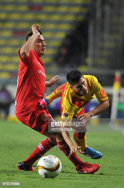 Gaston Lezcano of Morelia vies for the ball with Antonio Rios of Toluca during their quarter final Mexican Apertura tournament football match at the...