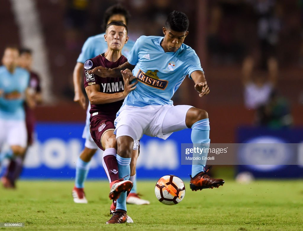 Gaston Lodico of Lanus fights for the ball with Alexis Rojas of Sporting Cristal during a first leg match between Lanus and Sporting Cristal as part of first round of Copa CONMEBOL Sudamericana 2018 at Ciudad de Lanus Stadium on February 21, 2018 in Lanus, Argentina.