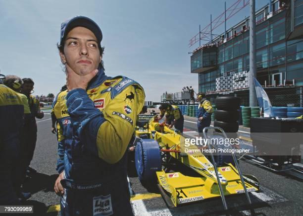 Gaston Mazzacane of Argentina prepares to drive the Telefonica Minardi Fondmetal Minardi M02 Fondmetal V10 before the start of the Formula One French...