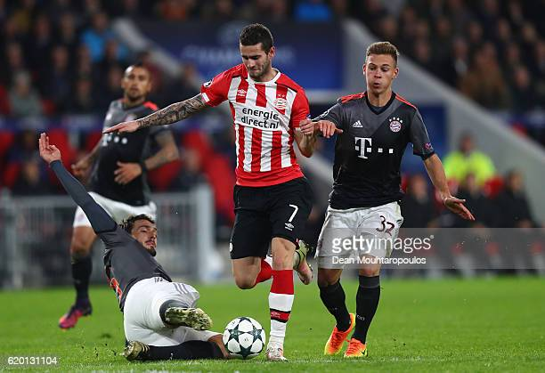 Gaston Pereiro of PSV Eindhoven takes on Mats Hummels and Joshua Kimmich of Bayern Muenchen during the UEFA Champions League Group D match between...