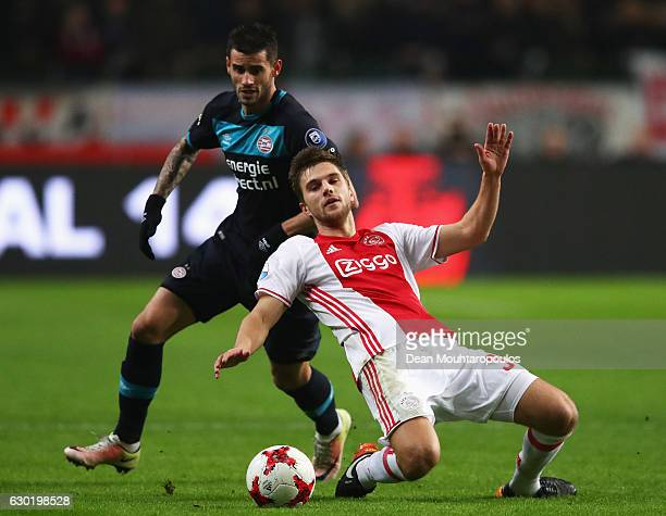 Gaston Pereiro of PSV fouls Joel Veltman of Ajax during the Eredivisie match between Ajax Amsterdam and PSV Eindhoven held at Amsterdam Arena on...