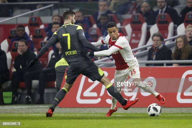 Gaston Pereiro of PSV Justin Kluivert of Ajax during the Dutch Eredivisie match between Ajax Amsterdam and PSV Eindhoven at the Amsterdam Arena on...
