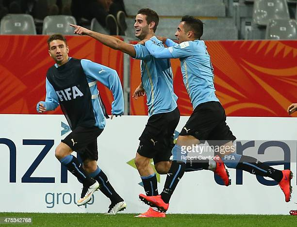 Gaston Pereiro of Uruguay celebrates with team mates after scoring a goal during the FIFA U-20 World Cup New Zealand 2015 Group D match between...