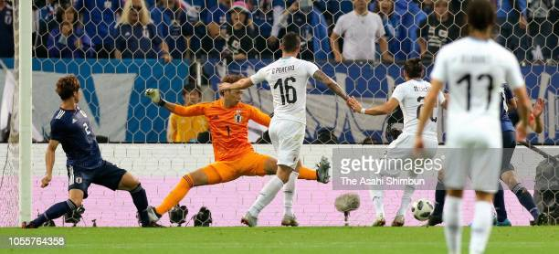 Gaston Pereiro of Uruguay scores his side's first goal during the international friendly match between Japan and Uruguay at Saitama Stadium on...