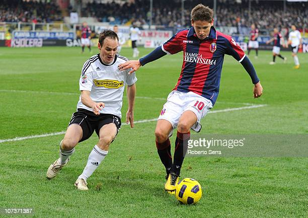 Gaston Ramirez of Bologna competes with Steve Von Bergen of Cesena during the Serie A match between Cesena and Bologna at Dino Manuzzi Stadium on...