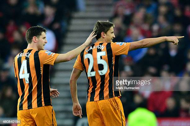 Gaston Ramirez of Hull City celebrates with teammate Alex Bruce of Hull City after scoring a goal to level the scores at 11 during the Barclays...