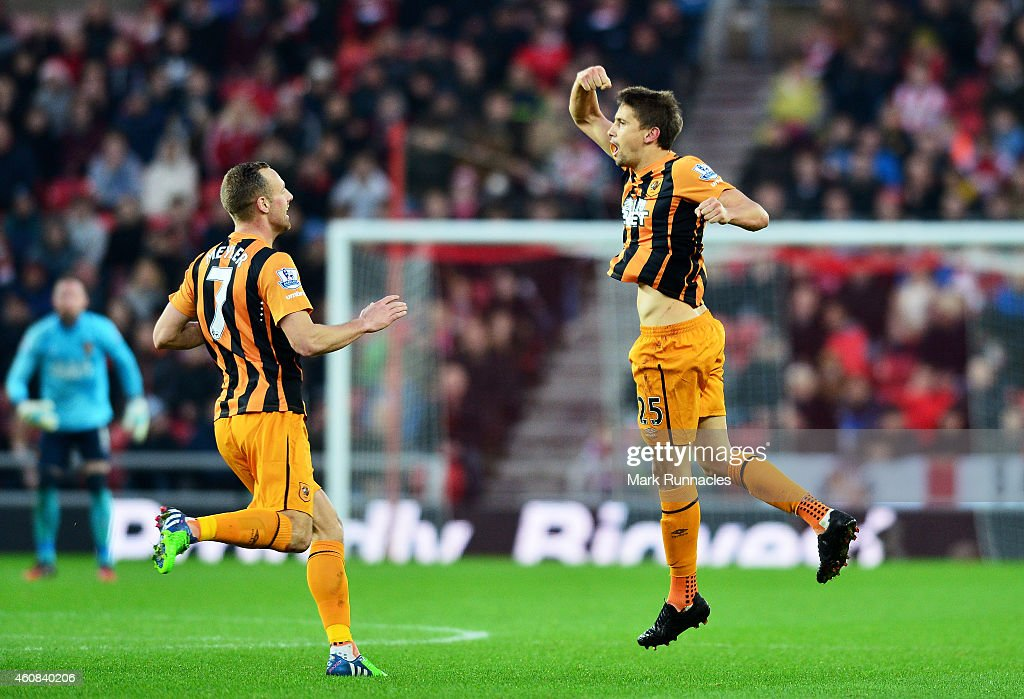 Gaston Ramirez (R) of Hull City celebrates with teammate David Meyler of Hull City after scoring a goal to level the scores at 1-1 during the Barclays Premier League match between Sunderland and Hull City at the Stadium of Light on December 26, 2014 in Sunderland, England.