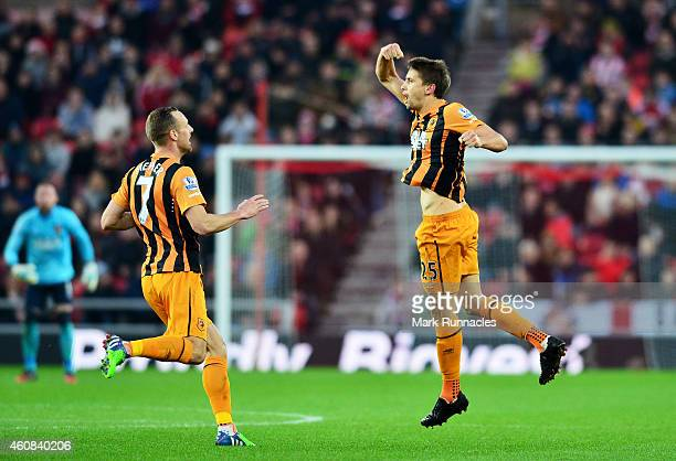 Gaston Ramirez of Hull City celebrates with teammate David Meyler of Hull City after scoring a goal to level the scores at 11 during the Barclays...