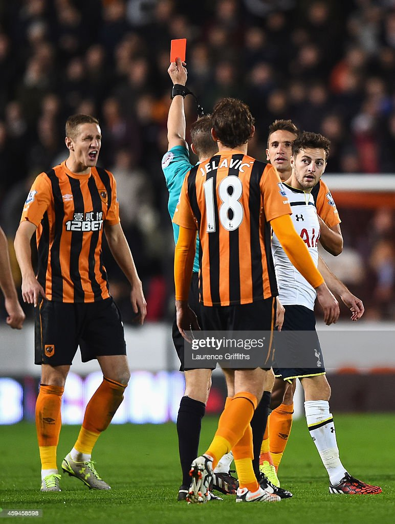 Gaston Ramirez of Hull City is shown the red card by referee Craig Pawson during the Barclays Premier League match between Hull City and Tottenham Hotspur at KC Stadium on November 23, 2014 in Hull, England.