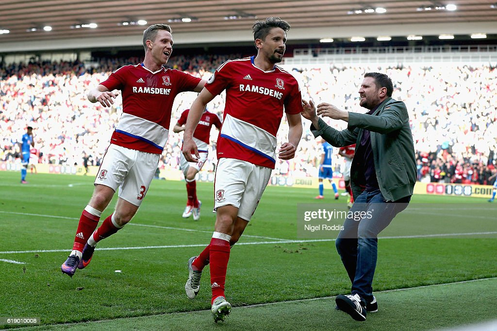 Gaston Ramirez (R) of Middlesbrough celebrates scoring the opening goal with an invading supporter during the Premier League match between Middlesbrough and AFC Bournemouth at the Riverside Stadium on October 29, 2016 in Middlesbrough, England.