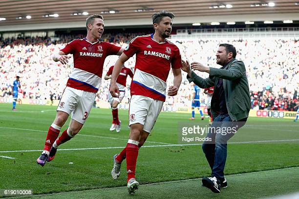 Gaston Ramirez of Middlesbrough celebrates scoring the opening goal with an invading supporter during the Premier League match between Middlesbrough...