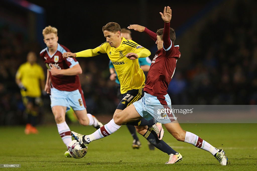 Gaston Ramirez of Middlesbrough is challenged by Matthew Lowton of Burnley during the Sky Bet Championship match between Burnley and Middlesbrough at Turf Moor on April 19, 2016 in Burnley, United Kingdom.
