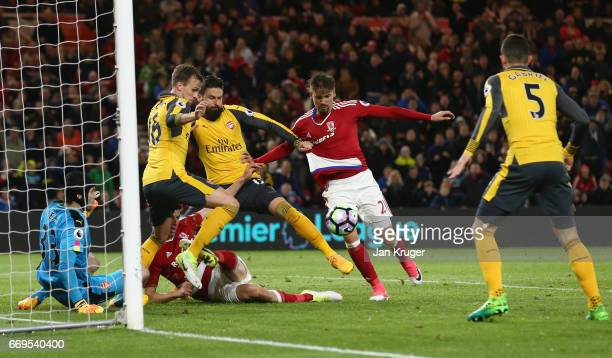 Gaston Ramirez of Middlesbrough is foiled by the Arsenal defence during the Premier League match between Middlesbrough and Arsenal at Riverside...