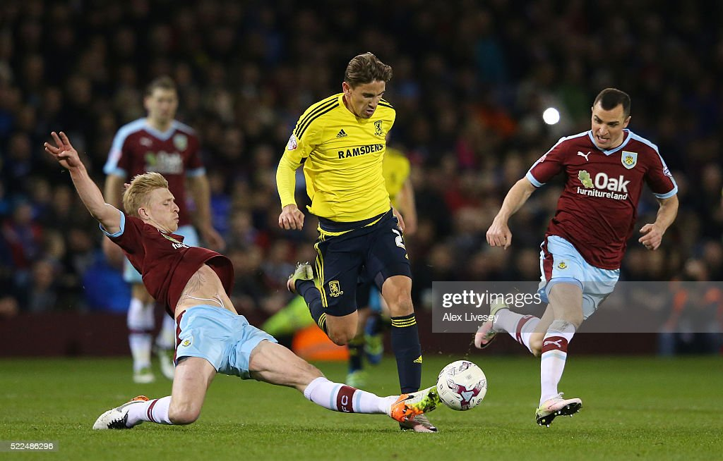 Gaston Ramirez of Middlesbrough is tackled by Ben Mee of Burnley during the Sky Bet Championship match between Burnley and Middlesbrough at Turf Moor on April 19, 2016 in Burnley, United Kingdom.