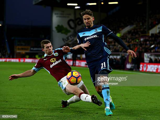 Gaston Ramirez of Middlesbrough is tackled by Jon Flanagan of Burnley during the Premier League match between Burnley and Middlesbrough at Turf Moor...