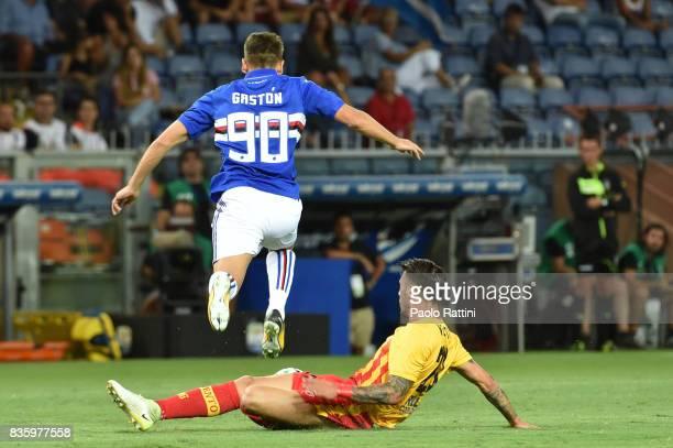 Gaston Ramirez of Sampdoria is tackled by Lorenzo Venuti of Benevento during the Serie A match between UC Sampdoria and Benevento Calcio at Stadio...