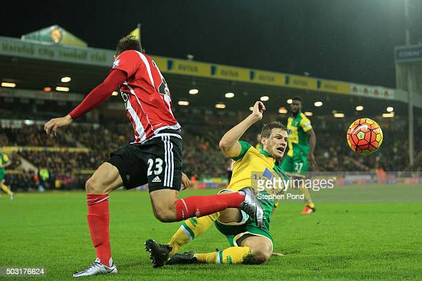 Gaston Ramirez of Southampton and Ryan Bennett of Norwich City compete for the ball during the Barclays Premier League match between Norwich City and...