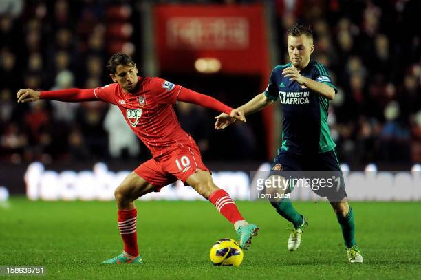 Gaston Ramirez of Southampton and Seabastian Larsson of Sunderland compete for the ball during the Barclays Premier League match between Southampton...