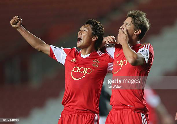 Gaston Ramirez of Southampton celebrates with Tadanari Lee after scoring the opening goal waith Tadanari Lee during the Capital One Cup Third Round...