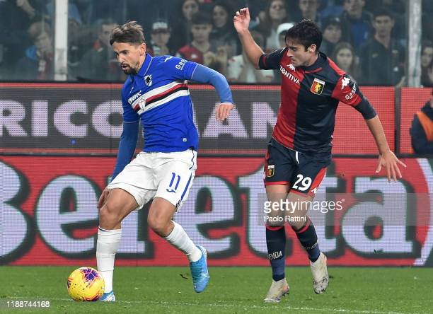 Gaston Ramirez of UC Sampdoria and Francesco Cassata of Genoa CFC compete for the ball during the Serie A match between Genoa CFC and UC Sampdoria at...