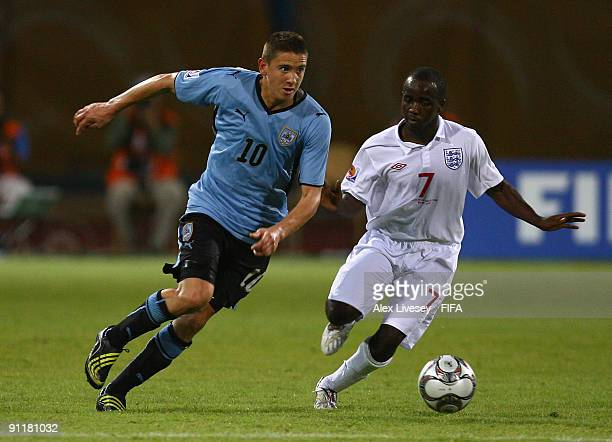 Gaston Ramirez of Uruguay beats Febian Brandy of England during the FIFA U20 World Cup Group D match between England and Uruguay at the Ismailia...
